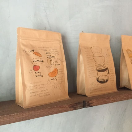 Coffee bag art at Roots