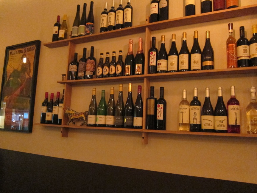 The wine selection on the wall